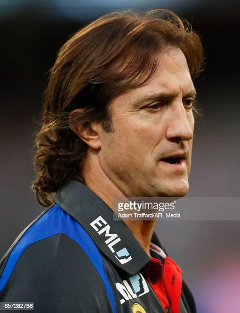 Luke Beveridge Senior Coach of the Bulldogs looks on during the 2017 AFL round 01 match between the Collingwood Magpies and the Western Bulldogs at...