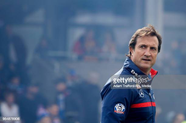 Luke Beveridge Senior Coach of the Bulldogs looks on during the 2018 AFL round seven match between the Western Bulldogs and the Gold Coast Suns at...