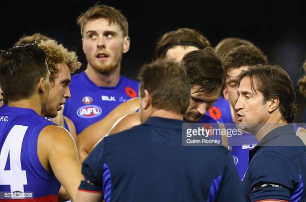 Luke Beveridge the coach of the Bulldogs talks to his players during the round five AFL match between the Western Bulldogs and the Brisbane Lions at...