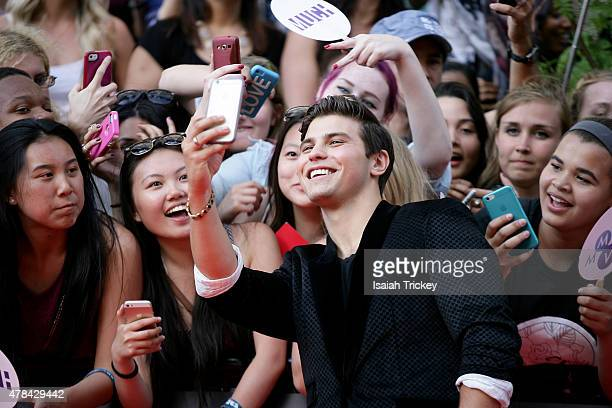 Luke Bilyk arrives at the 2015 MuchMusic Video Awards at MuchMusic HQ on June 21 2015 in Toronto Canada