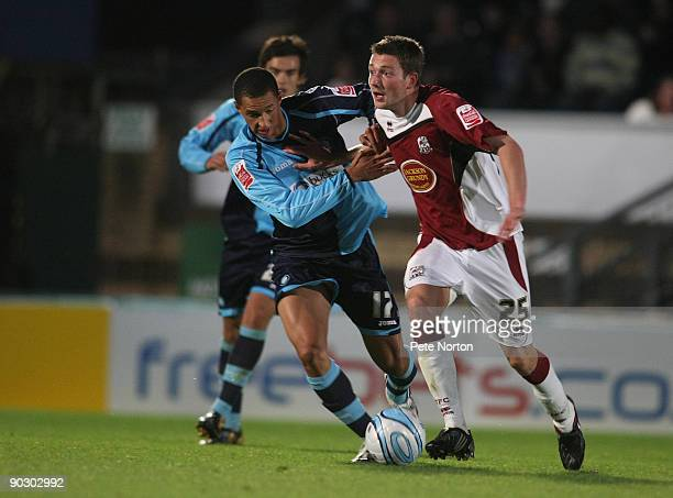 Luke Boden of Northampton Town attempts to move past Lewis Montrose of Wycombe Wanderers during the Johnstone's Paint Trophy First Round Match...