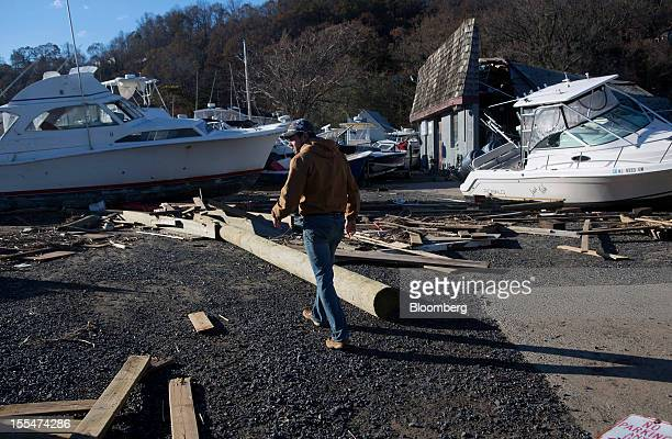 Luke Bollerman walks through damage from Hurricane Sandy in the marina and trailer park his family own in Highlands New Jersey US on Saturday Nov 3...