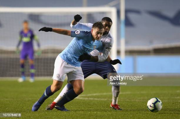 Luke Bolton of Manchester City holds off a challenge from Japhet Tanganga of Tottenham Hotspur during the Premier League 2 match between Manchester...