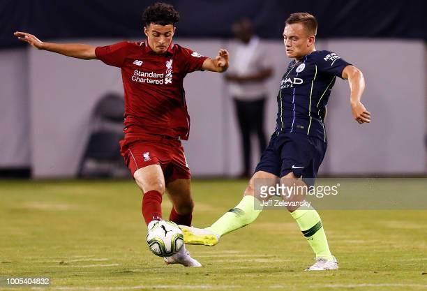 Luke Bolton of Manchester City moves the ball in front of Curtis Jones of Liverpool during their match at MetLife Stadium on July 25 2018 in East...