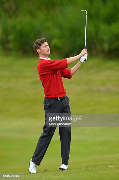 Luke Bone of Farnham Golf Club plays his approach shot to the 17th during the first round of the Lombard Trophy Grand Final at Gleneagles on...