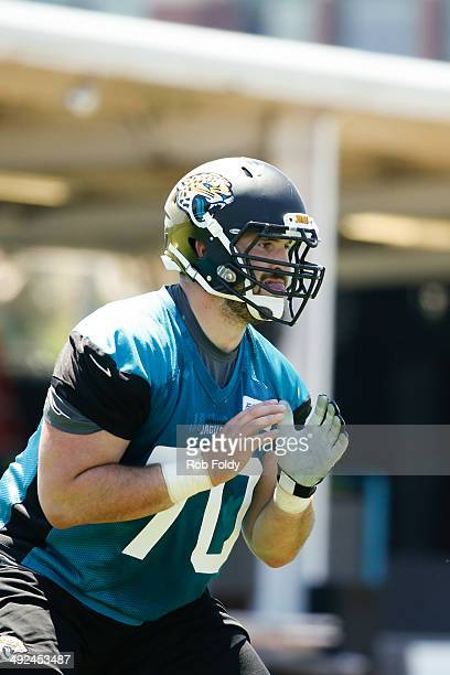 Luke Bowanko of the Jacksonville Jaguars defends during rookie minicamp at Everbank Field on May 16 2014 in Jacksonville Florida