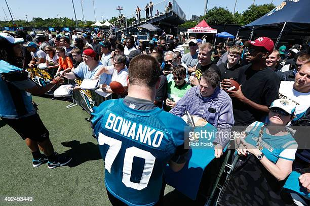 Luke Bowanko of the Jacksonville Jaguars signs autographs for fans after rookie minicamp at Everbank Field on May 16 2014 in Jacksonville Florida
