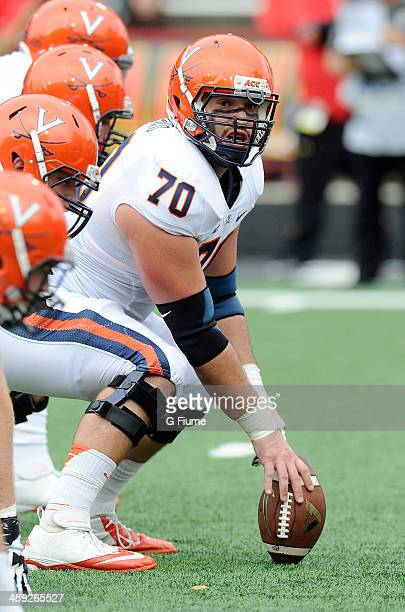 Luke Bowanko of the Virginia Cavaliers lines up at the line of scrimmage against the Maryland Terrapins at Byrd Stadium on October 12 2013 in College...