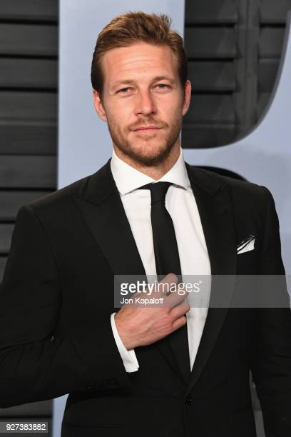 Luke Bracey attends the 2018 Vanity Fair Oscar Party hosted by Radhika Jones at Wallis Annenberg Center for the Performing Arts on March 4 2018 in...