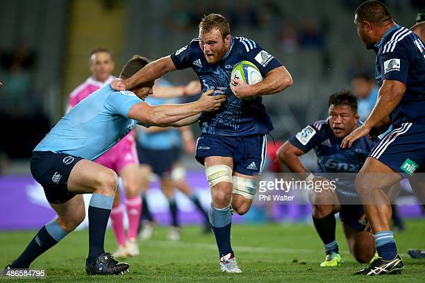 Luke Braid of the Blues is tackled by Dave Dennis of the Waratahs during the round 11 Super Rugby match between the Blues and the Waratahs at Eden...