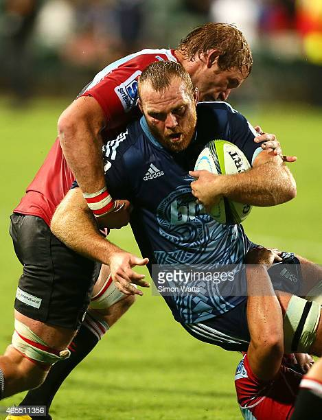 Luke Braid of the Blues is tackled during the round four Super Rugby match between the Blues and the Lions at QBE Stadium on March 7 2015 in Auckland...