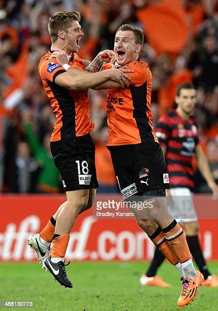 Luke Brattan and Besart Berisha of the Roar celebrate victory as the full time siren sounds the 2014 ALeague Grand Final match between the Brisbane...