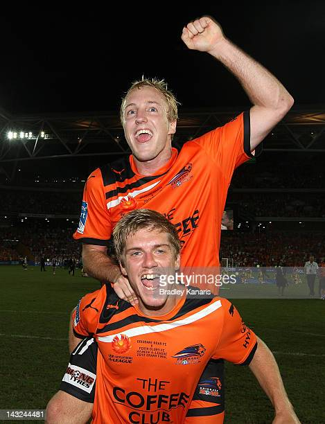 Luke Brattan and Mitchell Nichols of the Roar celebrate victory after the 2012 ALeague Grand Final match between the Brisbane Roar and the Perth...