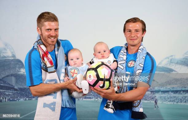 Luke Brattan of City holds his daughter Amaya and Nick Fitzgerald of City holds his son Harrison during a Melbourne City ALeague media opportunity on...