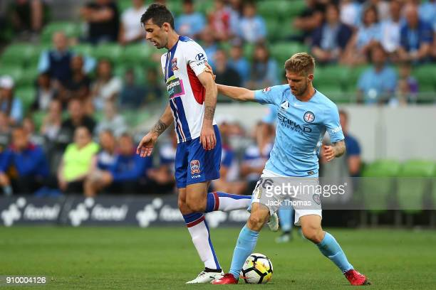 Luke Brattan of Melbourne City and Jason Hoffman of the Jets compete for the ball during the round 18 ALeague match between Melbourne City FC and the...