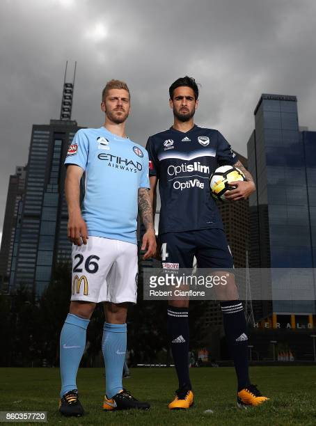 Luke Brattan of Melbourne City and Rhys Williams of Melbourne Victory pose during a Melbourne ALeague Derby Media Opportunity at Birrarung Mar on...