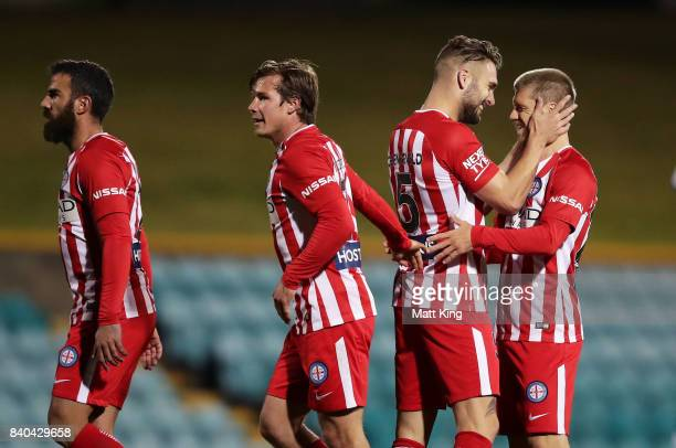Luke Brattan of Melbourne City celebrates with team mates after scoring a goal during the FFA Cup round of 16 match between Hakoah Sydney City East...