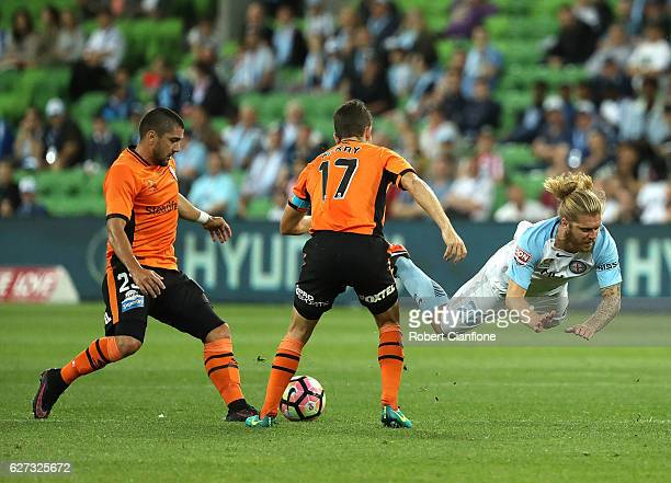 Luke Brattan of Melbourne City is challenged by Matt McKay of the Roar during the round nine ALeague match between Melbourne City FC and the Brisbane...