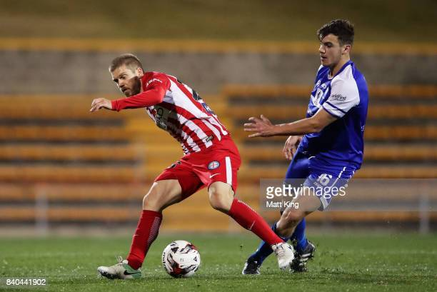 Luke Brattan of Melbourne City is challenged by Oliver Green of Hakoah during the FFA Cup round of 16 match between Hakoah Sydney City East and...
