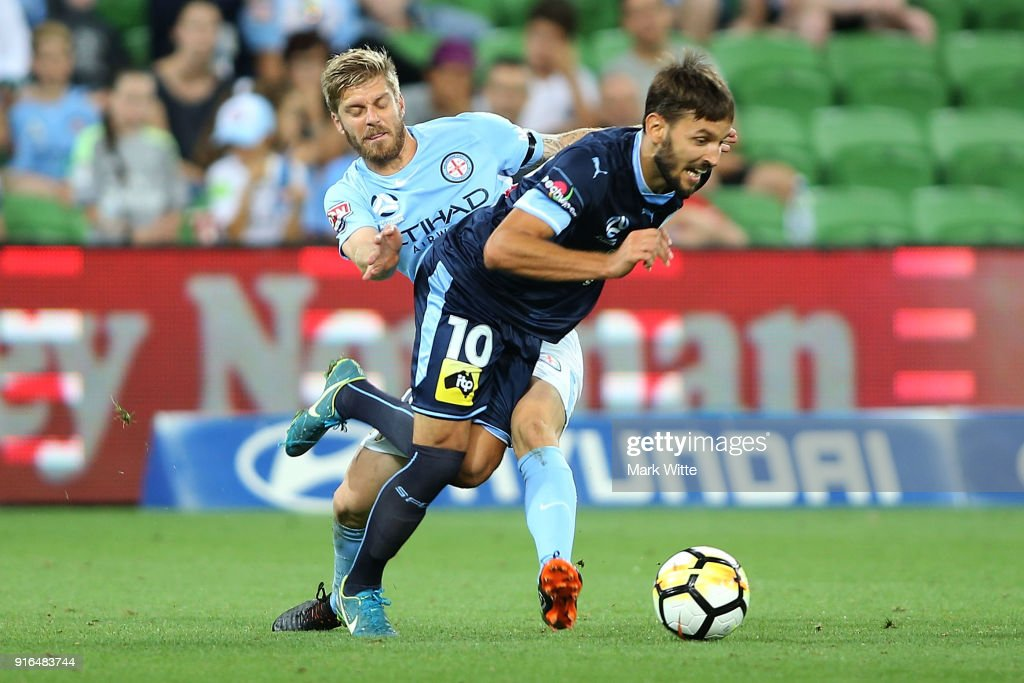 Luke Brattan of Melbourne City tries to get the ball of Milos Ninkovic of Sydney FC during the round 20 A-League match between Melbourne City and Sydney FC at AAMI Park on February 10, 2018 in Melbourne, Australia.