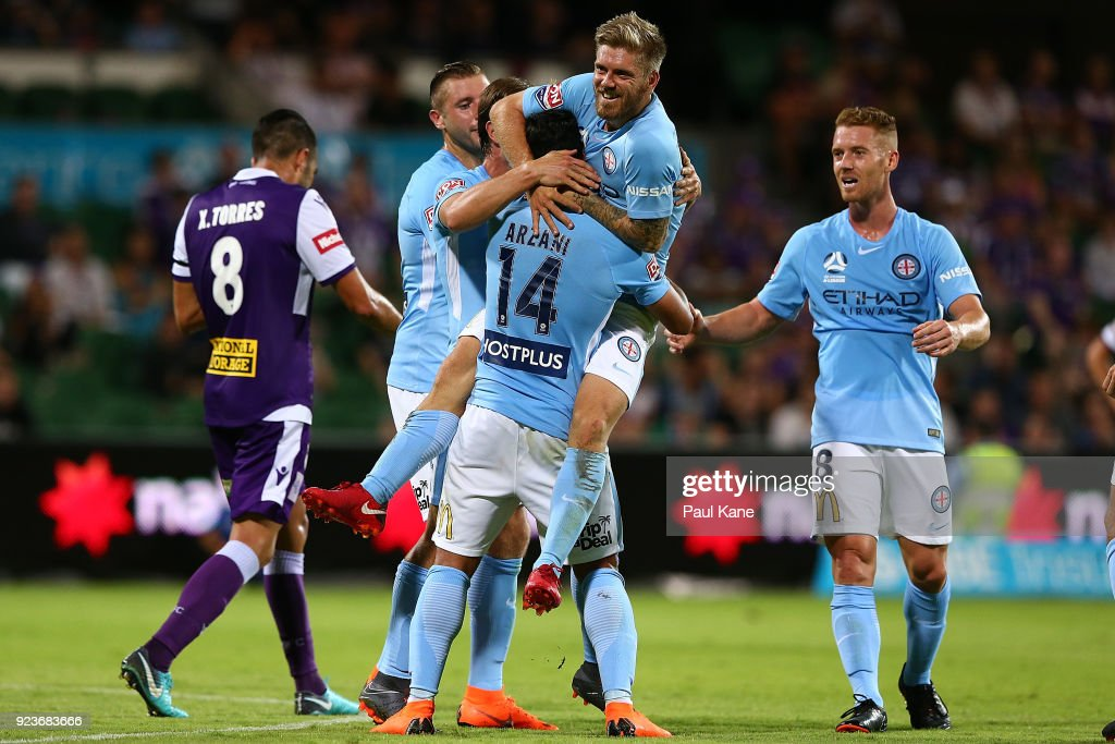 Luke Brattan of Melbourne congratulates Daniel Arzani after scoring a goal during the round 21 A-League match between the Perth Glory and Melbourne City FC at nib Stadium on February 24, 2018 in Perth, Australia.