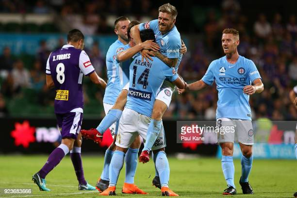 Luke Brattan of Melbourne congratulates Daniel Arzani after scoring a goal during the round 21 ALeague match between the Perth Glory and Melbourne...