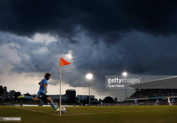 Luke Brattan of Sydney FC takes a corner kick as a storm approaches during the A-League match between Macarthur FC and Sydney FC at Campbelltown...