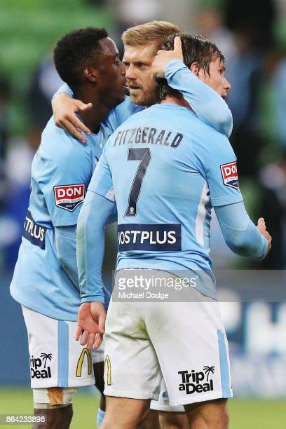 Luke Brattan of the City celebrates the win with Bruce Kamau and Nicholas Fitzgerald during the round three ALeague match between Melbourne City and...