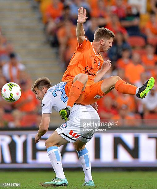 Luke Brattan of the Roar and Mate Dugandzic of Melbourne City challenge for the ball during the round five ALeague match between the Brisbane Roar...