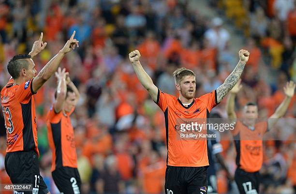 Luke Brattan of the Roar and team mates celebrate victory after the ALeague Semi Final match between the Brisbane Roar and Melbourne Victory at...