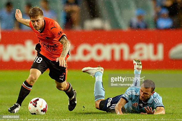 Luke Brattan of the Roar beats a tackle from Ranko Despotovic of Sydney during the round 12 ALeague match between Sydney FC and Brisbane Roar at...