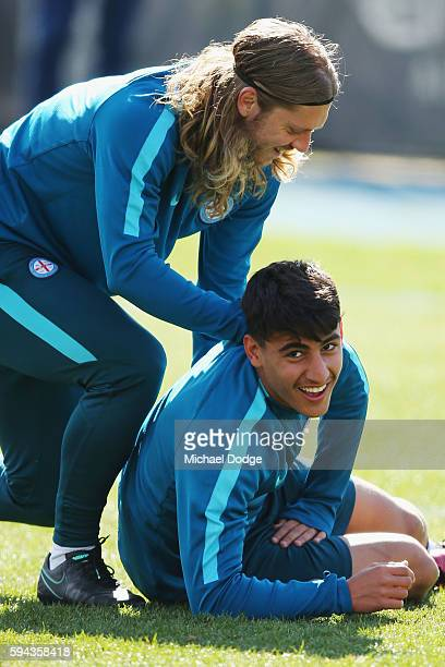 Luke Brattan wrestles Daniel Arzani to the ground during a Melbourne City FC ALeague training session ahead of their FFA Cup round of 16 match at La...