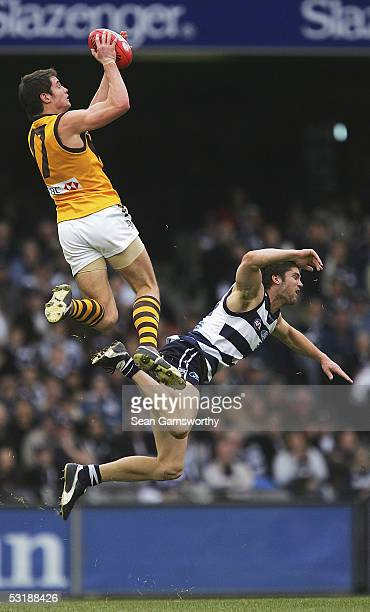 Luke Brennan for Hawthorn and Jared Rooke for Geelong in action during the AFL Round 14 match between the Geelong Cats and Hawthorn Hawks at the...