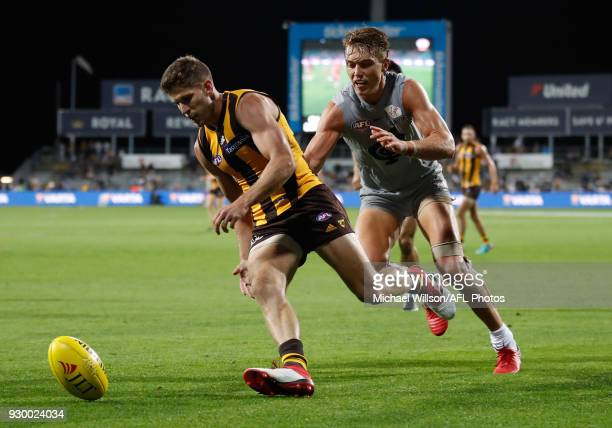 Luke Breust of the Hawks and Patrick Cripps of the Blues in action during the AFL 2018 JLT Community Series match between the Hawthorn Haws and the...