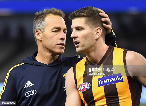 Luke Breust of the Hawks is congratulated by Hawks head coach Alastair Clarkson after kicking 6 goals during the round 16 AFL match between the...