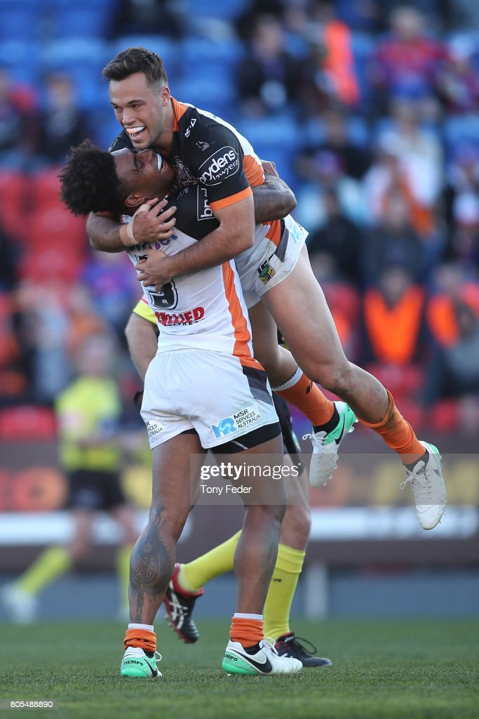 Luke Brooks and Kevin Naiqama of the Tigers celebrate a try during the round 17 NRL match between the Newcastle Knights and the Wests TIgers at McDonald Jones Stadium on July 2, 2017 in Newcastle, Australia.
