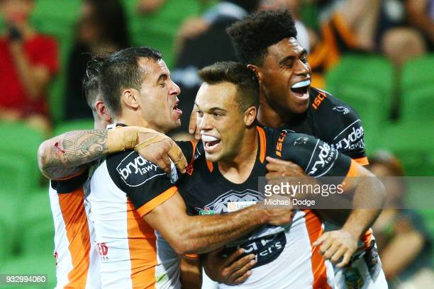 Luke Brooks of the Tigers celebrates a try in the dying stages during the round two NRL match between the Melbourne Storm and the Wests Tigers at...