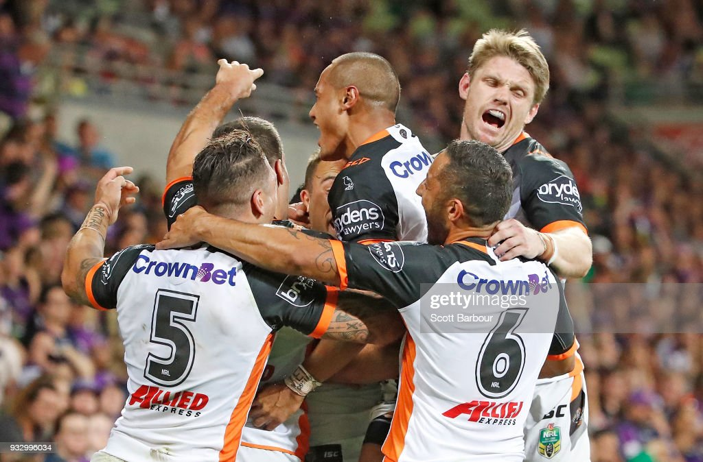 Luke Brooks of the Tigers is congratulated by his teammates after scoring the winning try during the round two NRL match between the Melbourne Storm and the Wests Tigers at AAMI Park on March 17, 2018 in Melbourne, Australia.