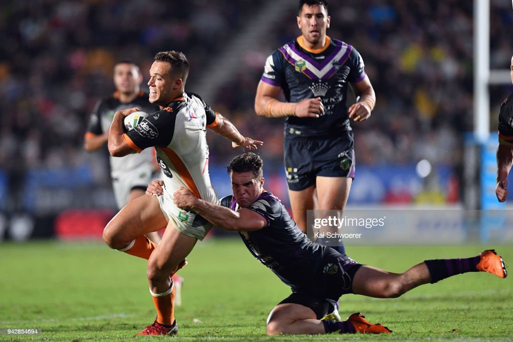 Luke Brooks of the Tigers is tackled by Brodie Croft of the Storm during the round five NRL match between the Wests Tigers and the Melbourne Storm at Mt Smart Stadium on April 7, 2018 in Auckland, New Zealand.