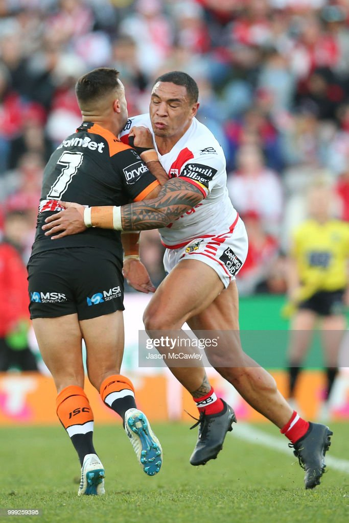 Luke Brooks of the Tigers is tackled by Tyson Frizell of the Dragons during the round 18 NRL match between the St George Illawarra Dragons and the Wests Tigers at UOW Jubilee Oval on July 15, 2018 in Sydney, Australia.