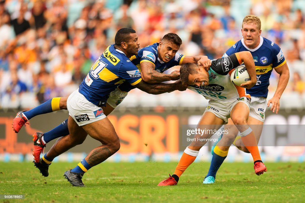 Luke Brooks of the Tigers is tackled during the round four NRL match between the Wests Tigers and the Parramatta Eels at ANZ Stadium on April 2, 2018 in Sydney, Australia.