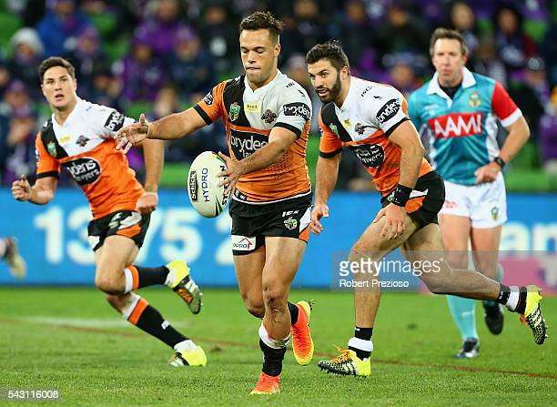 Luke Brooks of the Tigers kicks during the round 16 NRL match between the Melbourne Storm and Wests Tigers at AAMI Park on June 26 2016 in Melbourne...