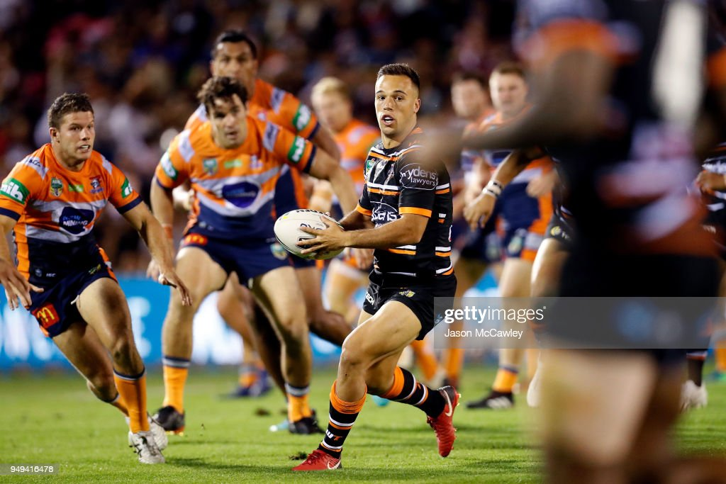 Luke Brooks of the Tigers runs the ball during the round seven NRL match between the Wests Tigers and the Newcastle Knights at Scully Park on April 21, 2018 in Tamworth, Australia.