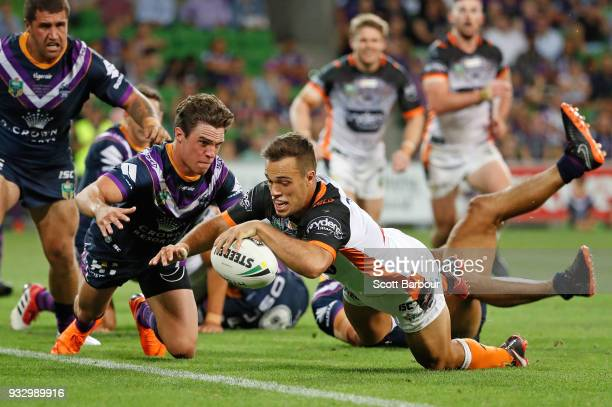 Luke Brooks of the Tigers scores the winning try during the round two NRL match between the Melbourne Storm and the Wests Tigers at AAMI Park on...
