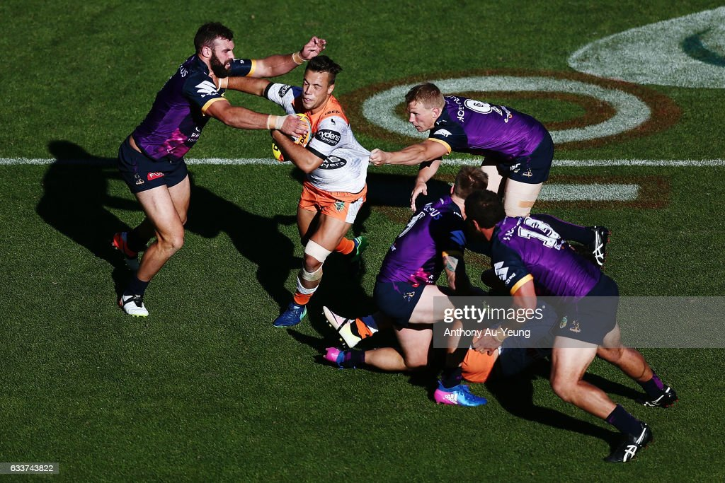 Luke Brooks of the Wests Tigers fends against Mark Nicholls of the Storm during the 2017 Auckland Nines match between the Wests Tigers and the Storm at Eden Park on February 4, 2017 in Auckland, New Zealand.