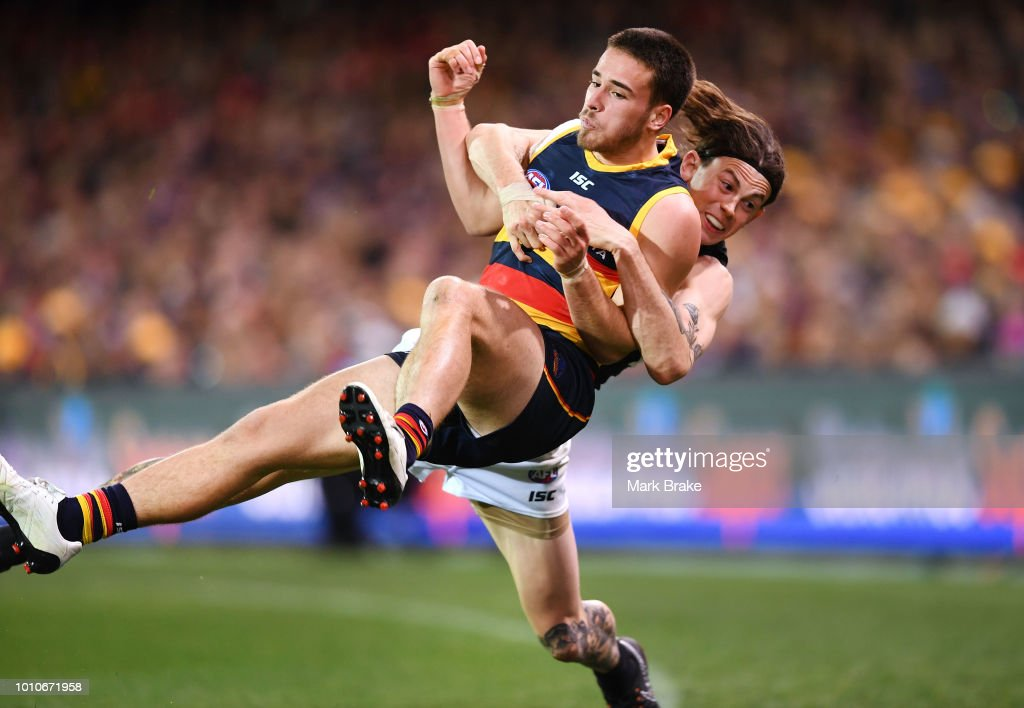 Luke Brown of the Adelaide Crows tackled over the boundary by Jasper Pittard of Port Adelaide during the round 20 AFL match between the Adelaide Crows and the Port Adelaide Power at Adelaide Oval on August 4, 2018 in Adelaide, Australia.