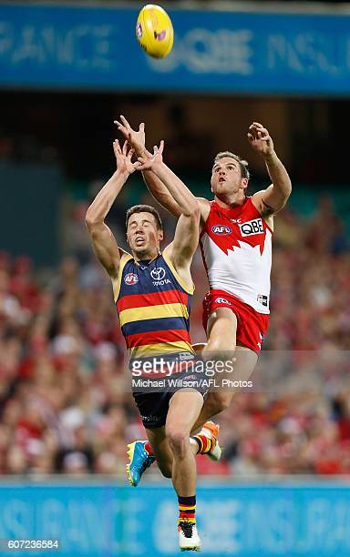 Luke Brown of the Crows and Ben McGlynn of the Swans compete for the ball during the 2016 AFL First Semi Final match between the Sydney Swans and the...