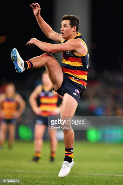 Luke Brown of the Crows kicks the ball during the round 17 AFL match between the Adelaide Crows and the Geelong Cats at Adelaide Oval on July 12 2018...