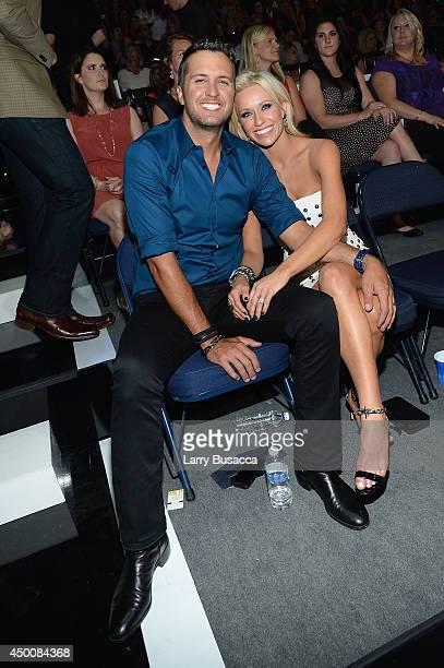 Luke Bryan and Caroline Bryan attend the 2014 CMT Music awards at the Bridgestone Arena on June 4 2014 in Nashville Tennessee
