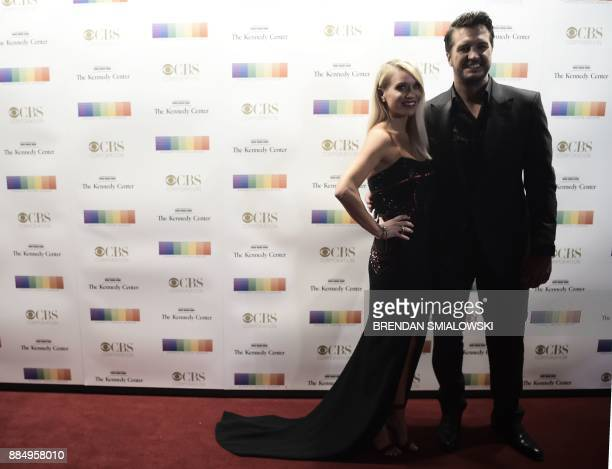 Luke Bryan and his wife Caroline Boyer arrive for the 40th Annual Kennedy Center Honors in Washington DC on December 3 2017 / AFP PHOTO / Brendan...
